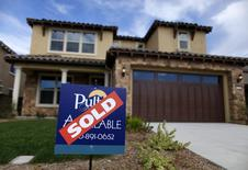 A newly-built home is shown as sold in a subdivision under construction in Carlsbad, California in this file photo taken February 21, 2012. REUTERS/Mike Blake/Files
