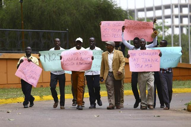 Supporters celebrate after Uganda's President Yoweri Museveni signed a law imposing harsh penalties for homosexuality in Kampala February 24, 2014. REUTERS/Edward Echwalu