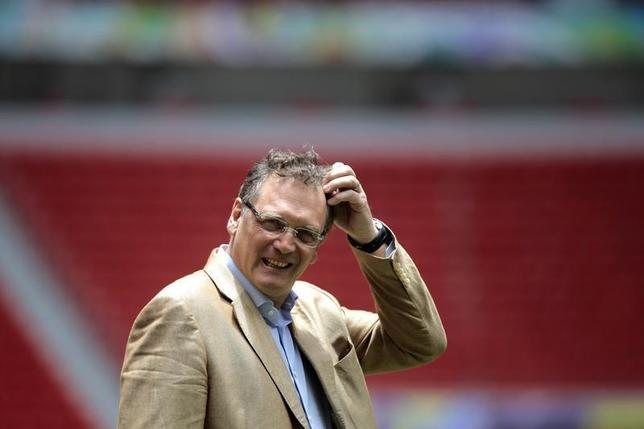 FIFA's Secretary General Jerome Valcke reacts during a visit to the Mane Garrincha National Stadium in Brasilia, February 17, 2014. REUTERS/Ueslei Marcelino