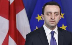 Премьер-министр Грузии Ираклий Гарибашвили на пресс-конференции в Брюсселе 3 февраля 2014 года. США замолвят слово за Грузию перед Евросоюзом, чтобы тот разрешил её гражданам безвизовый въезд, сказал госсекретарь Джон Керри в среду. REUTERS/Francois Lenoir