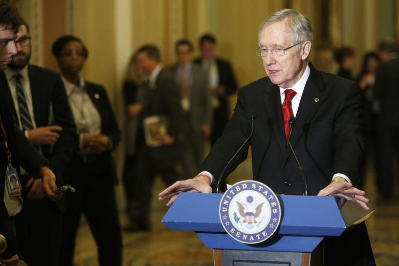 U.S. Senate Majority Leader Harry Reid (D-NV) addresses reporters at the U.S. Capitol in Washington, February 4, 2014. REUTERS/Jonathan Ernst