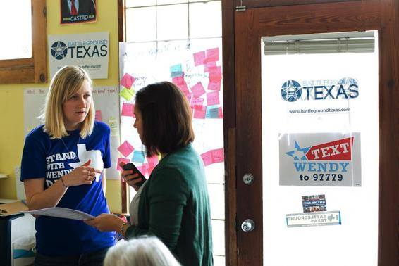 Battleground Texas regional field director Megan Klein (L), talks with volunteer April Crain during a phone call campaign encouraging early voting for Democratic gubernatorial candidate Wendy Davis in Austin, Texas on February 22, 2014. REUTERS/Julia Robinson
