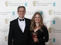 "Chris Buck and Jennifer Lee celebrate after winning the Animated Film category for ""Frozen"" at the British Academy of Film and Arts (BAFTA) awards ceremony at the Royal Opera House in London February 16, 2014. REUTERS/Suzanne Plunkett"