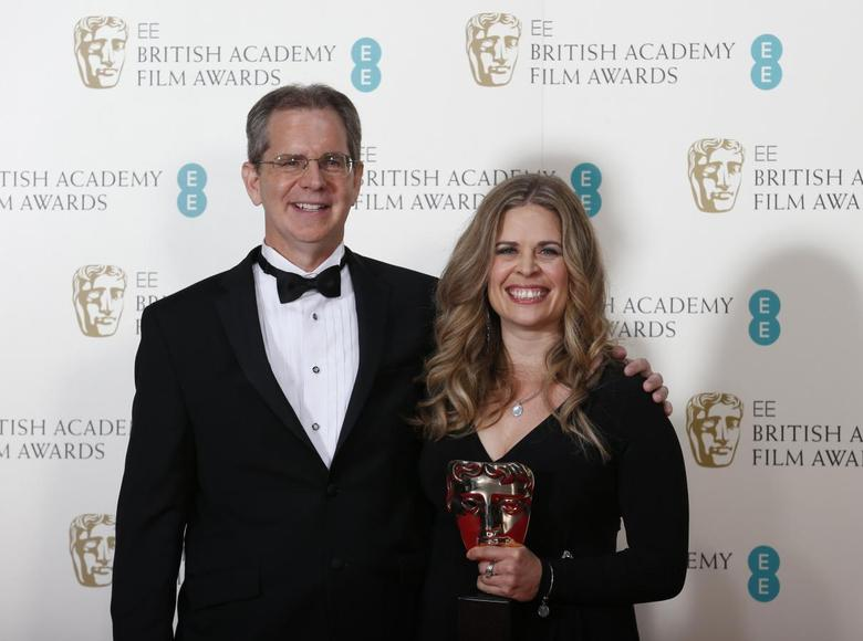 Chris Buck and Jennifer Lee celebrate after winning the Animated Film category for ''Frozen'' at the British Academy of Film and Arts (BAFTA) awards ceremony at the Royal Opera House in London February 16, 2014. REUTERS/Suzanne Plunkett