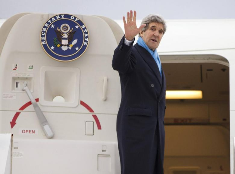 U.S. Secretary of State John Kerry waves as he boards his plane to return to the U.S., at Le Bourget Airport February 21, 2014. REUTERS/Evan Vucci/Pool