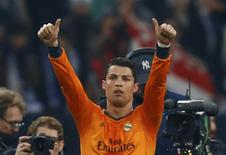 Real Madrid's Cristiano Ronaldo reacts after their Champions League soccer match against Schalke 04 in Gelsenkirchen February 26, 2014. REUTERS/Ralph Orlowski