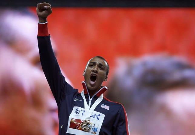 Gold medallist Ashton Eaton of the U.S. celebrates during the award ceremony for the men's decathlon during the IAAF World Athletics Championships at the Luzhniki stadium in Moscow August 11, 2013. REUTERS/Fabrizio Bensch