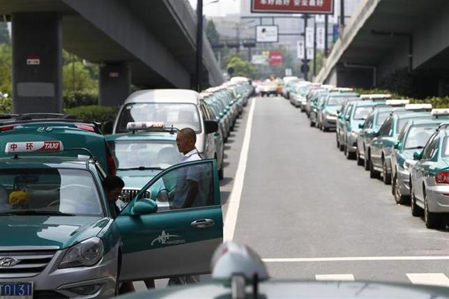 Striking taxi drivers gather near their parked taxis under a bridge in the suburbs of Hangzhou, Zhejiang province August 3, 2011. REUTERS/Aly Song/Files