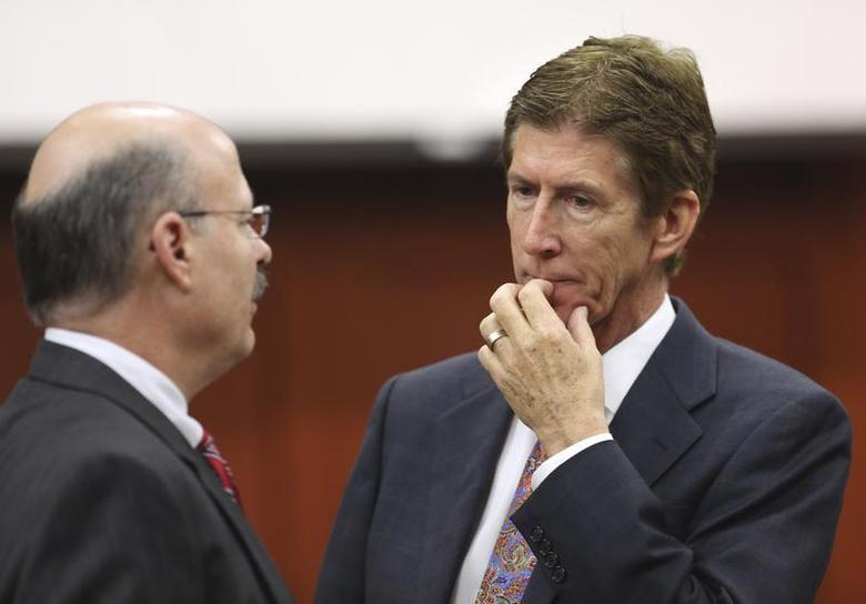 Defense counsel Mark O'Mara (R), talks to prosecutor Bernie de la Rionda during George Zimmerman's trial in Seminole circuit court in Sanford, Florida July 12, 2013. REUTERS/Gary W. Green/Pool