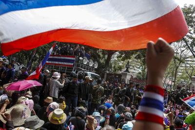 Thai PM faces negligence charges as protest leader...