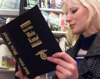 A young Czech woman reads a copy of Hitler's manifesto Mein Kampf in a central Prague's bookstore March 27.
