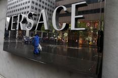 A sign is seen for high-end retail store Versace along 5th Avenue in New York May 19, 2013.REUTERS/Eric Thayer