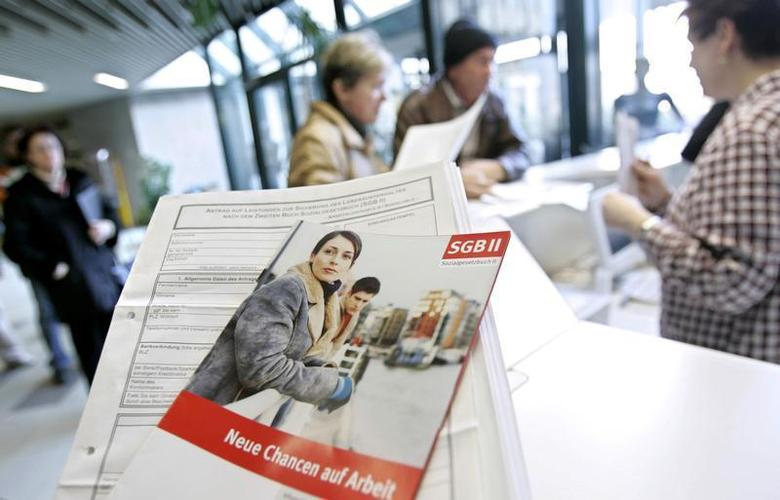 A flyer advertises for ''new chances for a job'' in a Federal Labour Office job centre in the western German town of Essen. REUTERS/Kirsten Neumann JOH