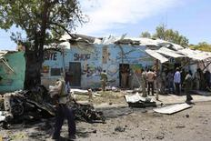 A Somali policeman walks at the scene of a suicide car bomb attack next to a tea shop in the suburbs of capital Mogadishu February 27, 2014. Islamist group al Shabaab claimed responsibility for a car bombing on Thursday that police said killed at least 10 people in the Somali capital Mogadishu and threatened more attacks. REUTERS/Feisal Omar (SOMALIA - Tags: CIVIL UNREST POLITICS)