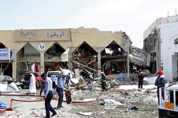 Rescue workers and policemen stand amidst debris near a Turkish restaurant following a gas explosion in Doha February 27, 2014. Twelve people were killed, including two children, and about 30 wounded when a gas tank exploded at the Turkish restaurant in the Qatari capital off Doha on Thursday, authorities in the Gulf Arab state reported. REUTERS-Stringer