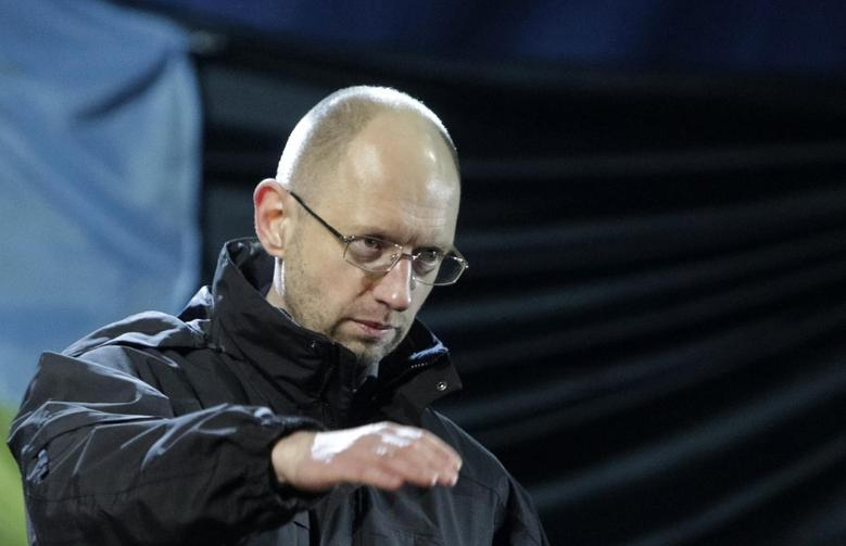 Former economy minister Arseny Yatseniuk gestures on the stage during a rally in Independence Square in Kiev, February 26, 2014. REUTERS/Konstantin Chernichkin