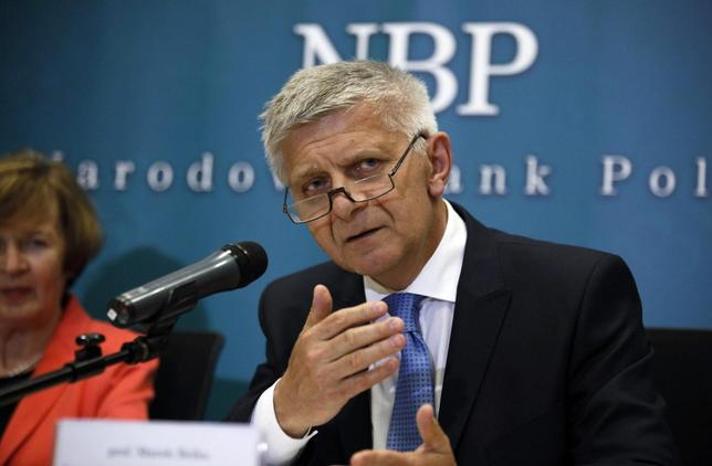 Marek Belka, Poland's central bank governor, gestures as he answers a question during a news conference at the bank's headquarters in Warsaw June 5, 2013. The cycle of interest rate cuts implemented by Poland's central bank is nearing an end, Belka said on Wednesday. REUTERS/Kacper Pempel