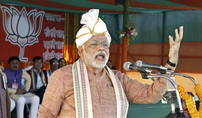 Gujarat's chief minister and Hindu nationalist Narendra Modi, the prime ministerial candidate for main opposition Bharatiya Janata Party (BJP), wearing a turban addresses his supporters during a rally ahead of the 2014 general elections in Assam February 22, 2014. REUTERS/Stringer