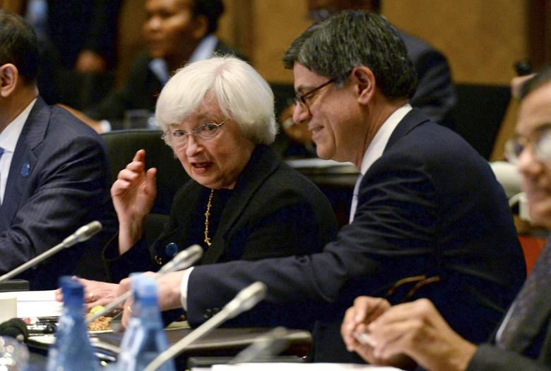 U.S. Federal Reserve Chairman Janet Yellen (L) chats with U.S. Treasury Secretary Jack Lew before the G20 Finance Ministers and Central Bank Governors round table meeting in Sydney, February 22, 2014. REUTERS/William West/Pool