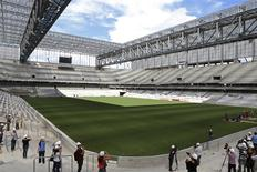 Journalists visit inside the Arena da Baixada soccer stadium as it is being built to host matches of the 2014 World Cup in Curitiba, February 24, 2014. REUTERS/Rodolfo Buhrer