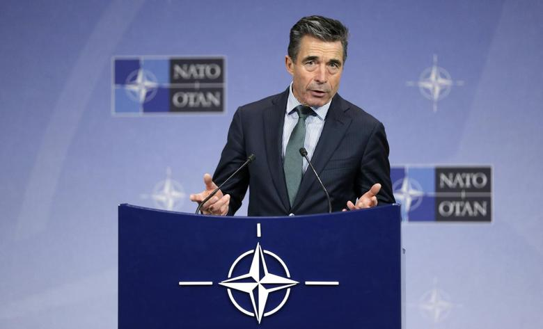 NATO Secretary-General Anders Fogh Rasmussen addresses a news conference during a NATO defence ministers meeting at the Alliance headquarters in Brussels February 27, 2014. REUTERS/Francois Lenoir