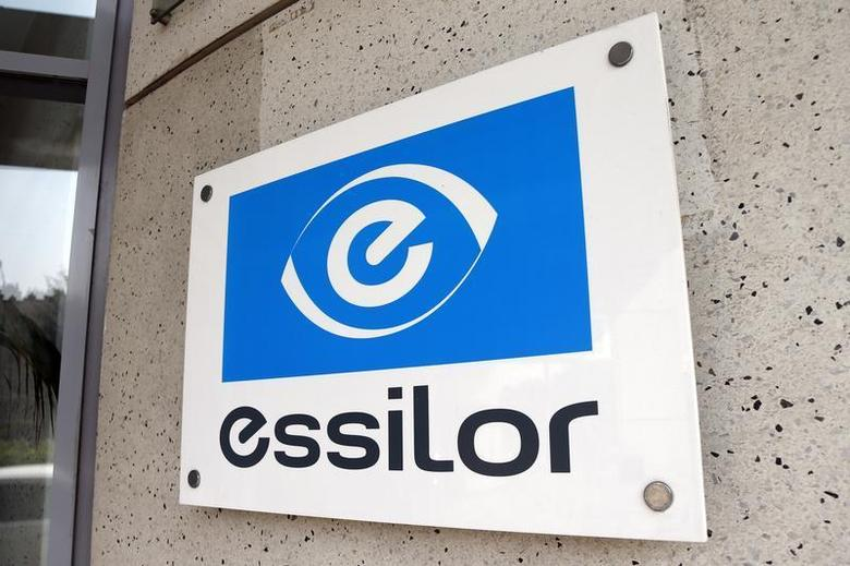 The logo of Essilor, the world's largest maker of ophthalmic lenses, is seen on the front of the company marketing headquarters in Vincennes near Paris August 29, 2013. REUTERS/Charles Platiau