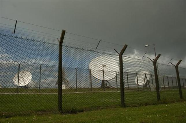 Satellite dishes are seen at GCHQ's outpost at Bude, close to where trans-Atlantic fibre-optic cables come ashore in Cornwall, southwest England June 23, 2013. REUTERS/Kieran Doherty/Files