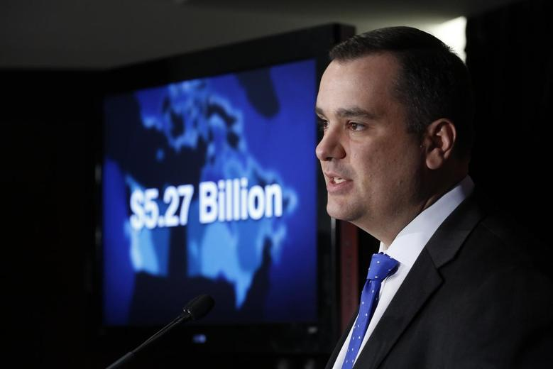 Canada's Industry Minister James Moore speaks during a news conference in Ottawa February 19, 2014. REUTERS/Chris Wattie