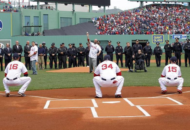 (L-R) Matt Paterson, who aided the injured during the Boston Marathon bombings, Steven Byrne, who was injured during the bombings, and Dick Hoyt and his son Richard Hoyt, who compete in the race every year, throw out the ceremonial first pitch together before MLB American League action between the Boston Red Sox and the Kansas City Royals at Fenway Park in Boston, Massachusetts April 20, 2013. REUTERS/Jessica Rinaldi