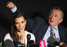 U.S. television personality Kim Kardashian (L) and her host Viennese millionaire mall developer Richard Lugner attend a news conference ahead of the Opera Ball in Vienna February 27, 2014. REUTERS/Heinz-Peter Bader