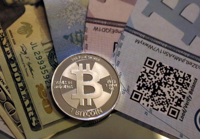 A physical bitcoin created by Mike Caldwell is seen in a photo illustration in Sandy, Utah, in this file photo taken September 17, 2013. REUTERS/Jim Urquhart/Files