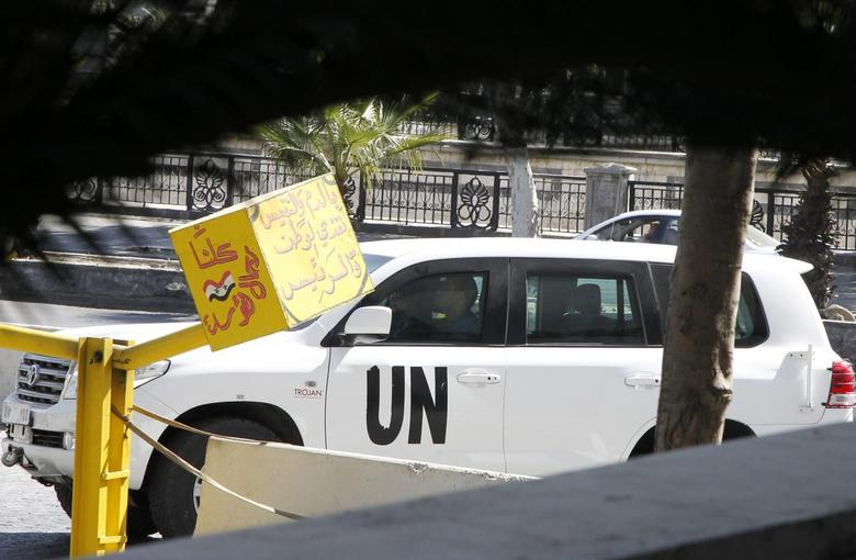 A U.N. vehicle returns to a hotel where experts from the Organisation for the Prohibition of Chemical Weapons (OPCW) are staying, in Damascus October 11, 2013 file photo. REUTERS/Khaled al-Hariri