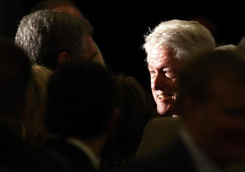 Former President Bill Clinton shakes hands with the crowd as he joins U.S. Democratic Senate candidate Alison Lundergan Grimes (not pictured) for a campaign event in Louisville, Kentucky February 25, 2014 file photo. REUTERS/John Sommers II