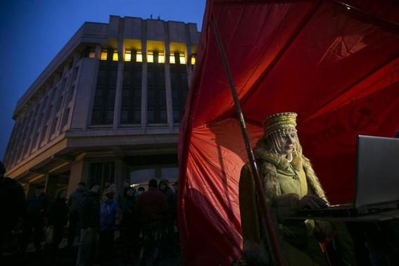 A pro-Russian DJ in traditional clothing looks at her computer during a rally outside the Crimean parliament building in Simferopol February 27, 2014. REUTERS/Baz Ratner