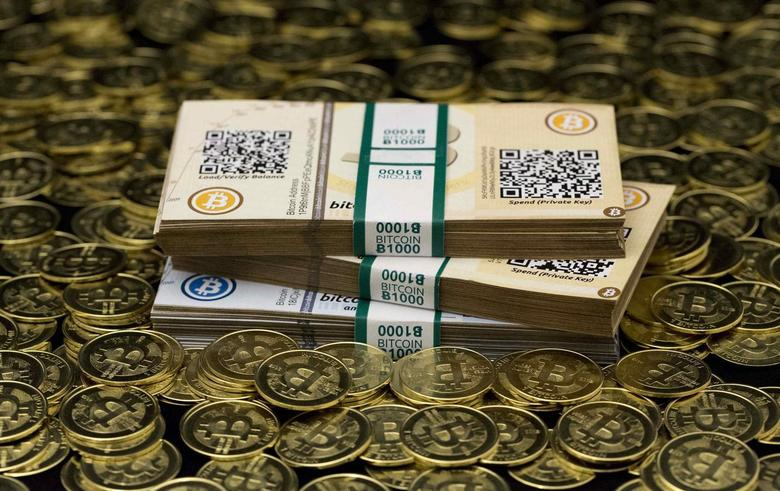 Some of Bitcoin enthusiast Mike Caldwell's coins and paper vouchers, often called ''paper wallets'', are pictured in this photo illustration taken in Sandy, Utah on January 31, 2014. REUTERS/Jim Urquhart/Files