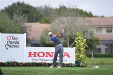 Feb 27, 2014; Palm Beach Gardens, FL, USA; Tiger Woods on the 12th tee at PGA National GC Champion Course. Mandatory Credit: Bob Donnan-USA TODAY Sports
