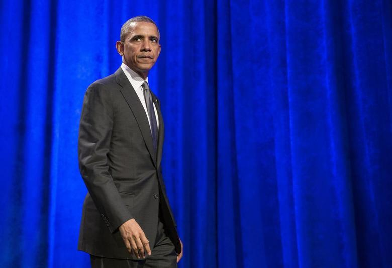 President Barack Obama walks after delivering remarks at Organizing for Action's ''National Organizing Summit'' in Washington February 25, 2014. REUTERS/Joshua Roberts