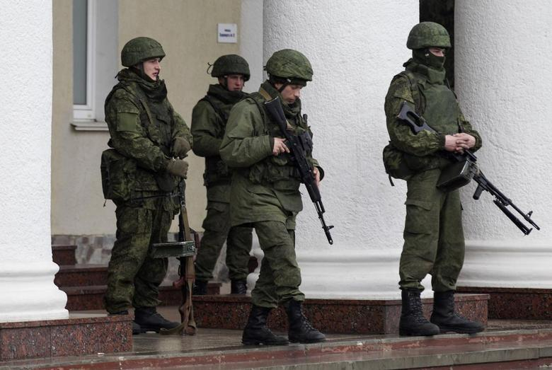 Armed men stand guard at the Simferopol airport in the Crimea region February 28, 2014. REUTERS/Baz Ratner