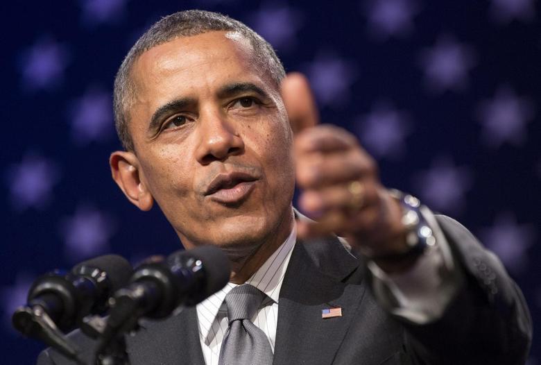 U.S. President Barack Obama delivers remarks at Organizing for Action's ''National Organizing Summit'' in Washington February 25, 2014. REUTERS/Joshua Roberts