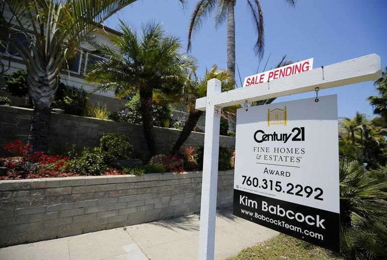 A single family home is shown with a sale pending in Encinitas, California May 22, 2013. REUTERS/Mike Blake