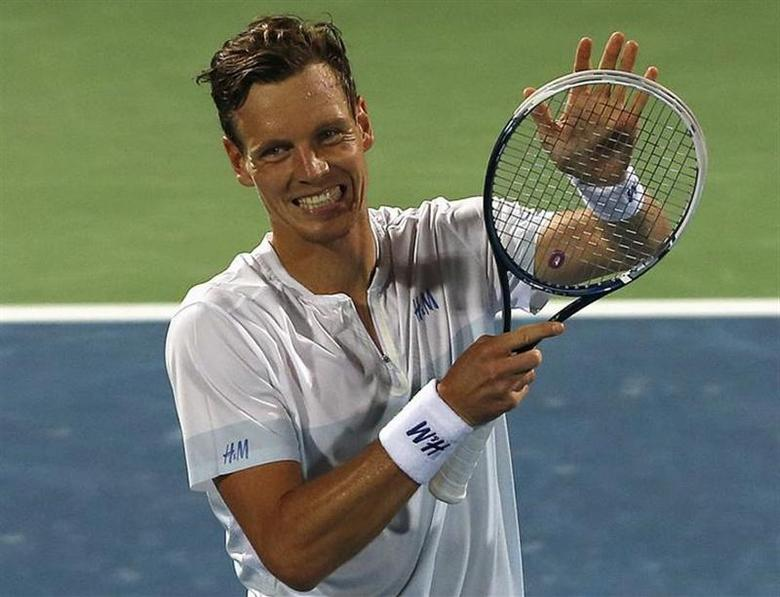 Tomas Berdych of Czech Republic celebrates after defeating Philipp Kohlschreiber of Germany in their men's singles semi-final match at the ATP Dubai Tennis Championships, February 28, 2014. REUTERS/Ahmed Jadallah