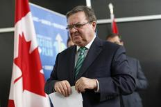 Canada's Finance Minister Jim Flaherty leaves following a news conference in Ottawa January 27, 2014. REUTERS/Chris Wattie