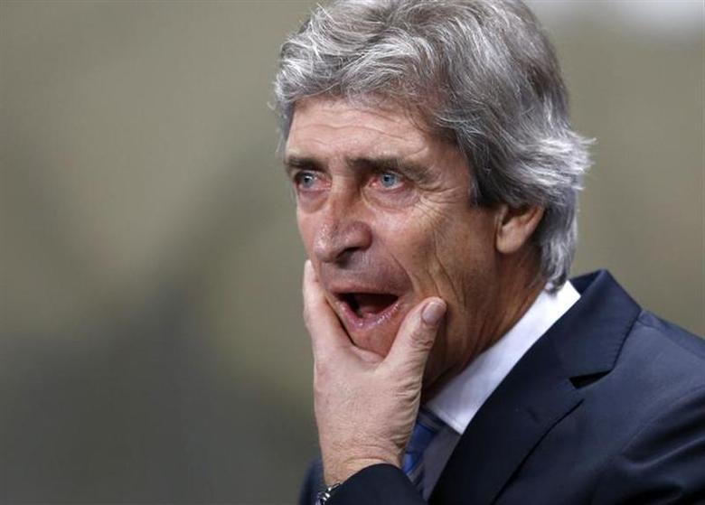Manchester City's manager Manuel Pellegrini reacts before their Champions League round of 16 first leg soccer match against Barcelona at the Etihad Stadium in Manchester, northern England February 18, 2014. REUTERS/Darren Staples