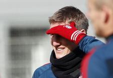O jogador alemão Bastian Schweinsteiger durante treinamento do Bayernn, em Munique. Nesta sexta-feira, o meio-campista voltou a ser convocado para a seleção alemã para a partida contra o Chile. 18/02/2014 REUTERS/Michaela Rehle