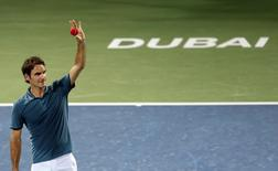Roger Federer of Switzerland celebrates after defeating Novak Djokovic of Serbia in their men's singles semi-final match at the ATP Dubai Tennis Championships, February 28, 2014. REUTERS/Saleh Salem