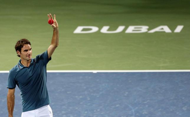 Roger Federer of Switzerland celebrates after defeating Novak Djokovic of Serbia in their men's singles semi-final match at the ATP Dubai Tennis Championships, February 28, 2014. REUTERS/Saleh Salem