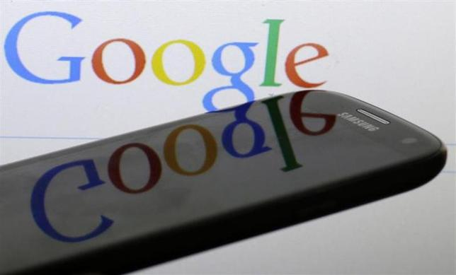A Google logo is reflected on the screen of a Samsung Galaxy S4 smartphone in this photo illustration taken in Prague January 31, 2014. REUTERS/David W Cerny/Files