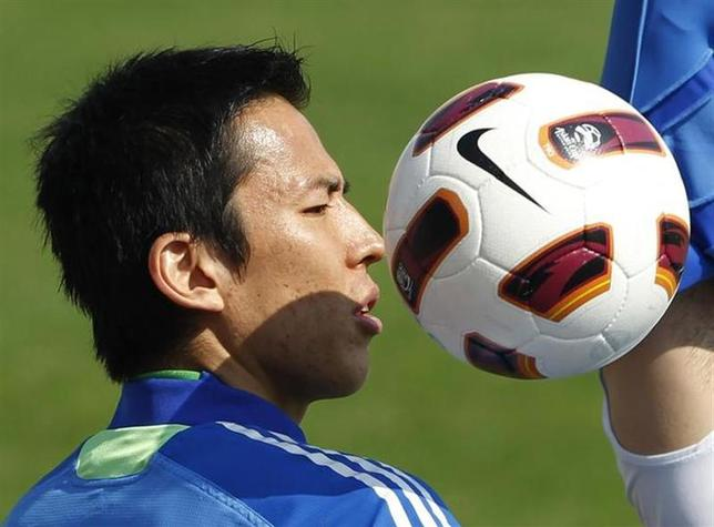 Japan's captain Makoto Hasebe attends a training session for the Asian Cup soccer tournament in Doha January 22, 2011. REUTERS/Toru Hanai/Files