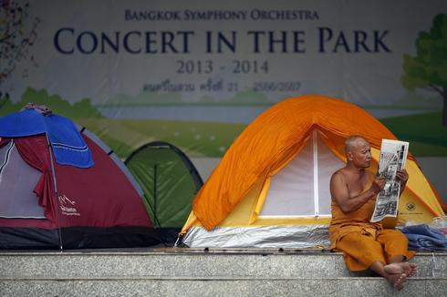 Thai Buddhist monk vows to fight on even as protesters scale back