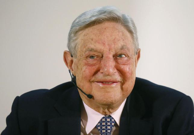 George Soros, Chairman of Soros Fund Management LLC smiles as he addresses the audience during an economic speech in Frankfurt April 9, 2013, on the topic 'How to save the European Union from the euro crisis.' REUTERS/Ralph Orlowski